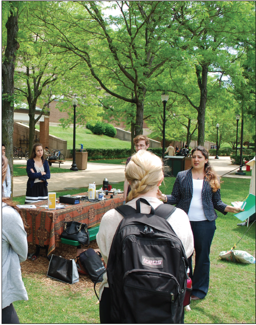 Students participate in a discussion with a Syrain refugee about her experiences fleeing her homeland and organizing protests. (Nathan Weisman/The DePaulia)