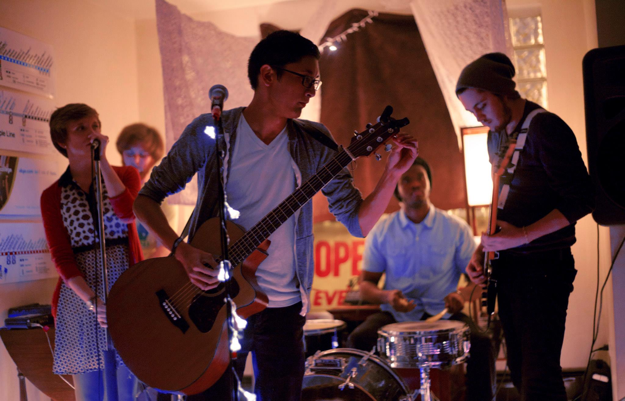 """Musicians playing """"The Rad Pad,"""" the name given to SAIC student Mylo Reyes's apartment that doubles as a performance space for local musicians. Photo by Parker Asmann."""