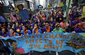 Marchers in New York City's People's Climate March, which drew hundreds of thousands of demonstrators to the city, Sept. 21. Photo courtesy Mel Evans/AP.