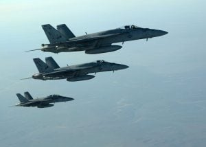 In this Tuesday, Sept. 23 photo released by the U.S. Air Force, a formation of U.S. Navy F-18E Super Hornets leaves after receiving fuel over northern Iraq, as part of U.S. led coalition airstrikes on the Islamic State group and other targets in Syria. Photo by Shaun Nickel/AP Exchange
