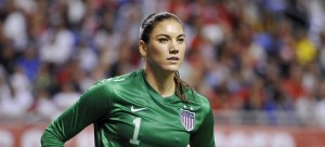 In this Oct. 20, 2013, file photo, United States goalkeeper Hope Solo pauses on the field during the second half of an international friendly women's soccer match against Australia in San Antonio. U.S. Soccer is standing by its decision to allow goalkeeper Hope Solo to continue to play while she faces domestic violence charges, Tuesday, Sept. 23, 2014. (AP Photo/Darren Abate, File)