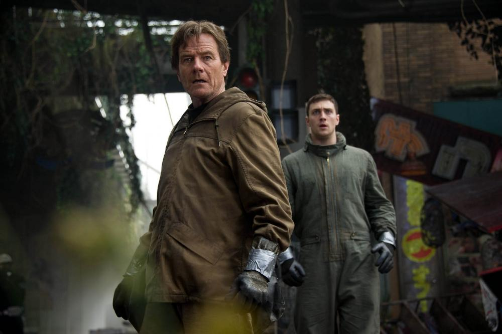 """Bryan Cranston, left, and Aaron Taylor-Johnson in the most recent film adaptation of """"Godzilla,"""" the giant lizard monster that has been central to several movies in past decades. (Photo courtesy of Warner Bros. Entertainment)"""