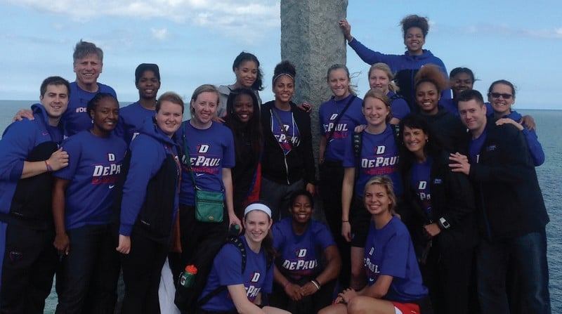 The women's basketball team poses in Normandy, France. They were there Aug. 11 to Aug. 22. (Photo courtesy of DePaul Athletics)