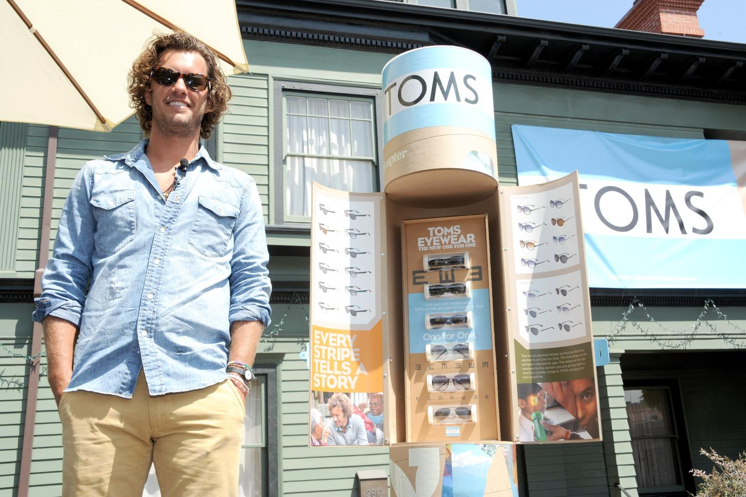 Blake Mycoskie, founder of TOMS, stands near a kiosk of TOMS-branded eyewear. (Photo courtesy of TOMS Shoes)