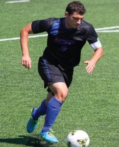 Senior Koray Yeselli goes for the ball. (Grant Myatt / The DePaulia)