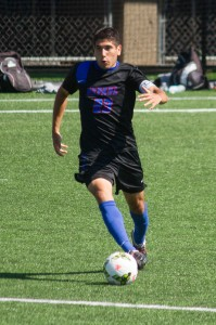 DePaul forward Art Garza goes back to kick the ball. (Grant Myatt / The DePaulia)