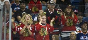 Chicago Blackhawks fans celebrate a goal against the Edmonton Oilers in preseason action. (Liam Richards / AP)