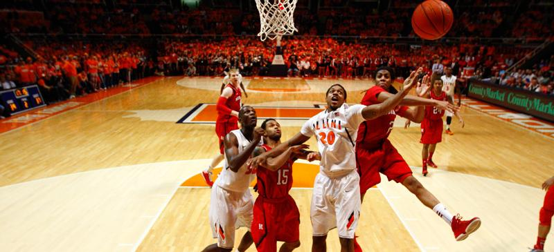 Former Illinois forward and current Blue Demon Myke Henry (20) has his shot blocked during the Illini's win against Nebraska. (Photo courtesy of Brenton Tse / The Daily Illini)