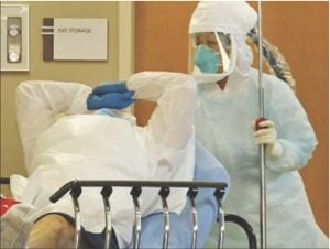 A patient in Dallas is treated because of possible signs of Ebola exposure. LOUIS DELUCA | AP / THE DALLAS MORNING NEWS