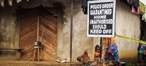 This sign stands outside a family home that has been placed under quarantine because of the Ebola virus in Port Loko, Sierra Leone. (Michael Duff | AP)