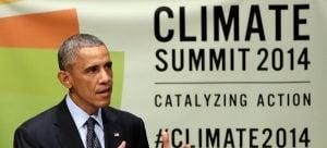 United States President Barack Obama addresses the Climate Summit, at United Nations headquarters, Tuesday, Sept. 23, 2014. (AP Photo/Richard Drew)