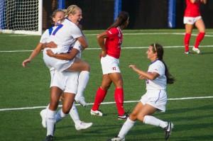 The women's soccer team celebrates a goal at the beginning of their season. (Grant Myatt / The DePaulia)