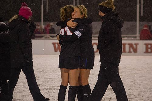 Junior captain Elise Wyatt hugs sophomore Abby Reed after their loss to Wisconsin. (Grant Myatt / The DePaulia)