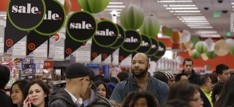 In this Nov. 28, 2013 file photo, customers shop at a Target store in Colma, Calif. Experts say Thanksgiving weekend lives up to the hype of serving up the best bargains of the year from TVs to clothing. Shoppers, however, need to do their homework before joining the crowds at the mall or heading online for the official kickoff that's increasingly creeping into the turkey feast. (AP Photo/Jeff Chiu, File)
