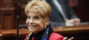 In this March 6, 2013 file photo, Illinois Comptroller Judy Baar Topinka gestures on the House floor at the state Capitol in Springfield, Ill. Topinka, who won a second term in November 2014, died early Wednesday morning, Dec. 10, 2014, less than 24 hours after having a stroke, according to her office. She was 70. Topinka previously served three terms as Illinois state treasurer, was a former Illinois GOP chairwoman and ran for governor in 2006. (AP Photo/Seth Perlman, File)