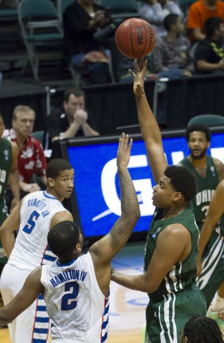 Ohio guard Antonio Campbell, right, shoots the basketball while being defended by DePaul center Tommy Hamilton IV (2) in the first half of an NCAA college basketball game at the Diamond Head Classic on Tuesday, Dec. 23, 2014, in Honolulu. DePaul guard Billy Garrett Jr. (5) looks on during the play. (AP/Photo Eugene Tanner)