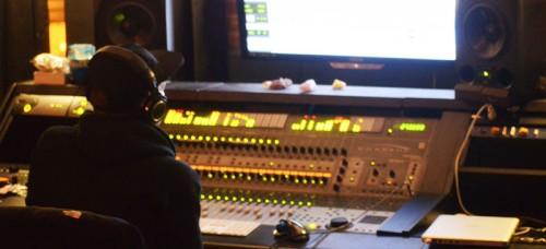 DePaul alumnus and hip-hop artist Dan Kanvis at Classick Studios in Humboldt Park. (Kevin Quin / The DePaulia)