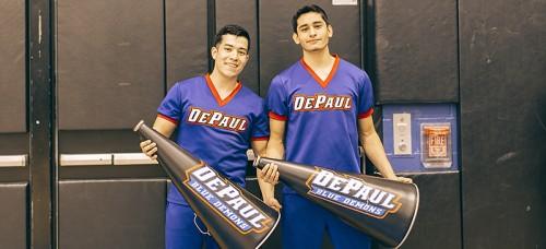 DePaul freshmen Henry Prado (left) and Irvin Bello (right) joined DePaul's cheerleading squad. (Josh Leff / The DePaulia)