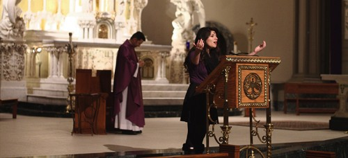 Junior Christina Teach led the congregation in song at DePaul's Ash Wednesday night mass. (Megan Deppen / The DePaulia)