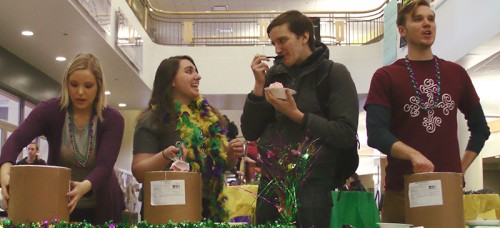 Senior Michael Hoppenrath (second from right) splurged on ice cream with the Catholic Student Union to celebrate Fat Tuesday, or Mardi Gras, the day before the beginning of Lent. (Megan Deppen / The DePaulia)