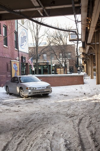 Many parking lots, such as this lot at Kelly's Pub, remain poorly plowed. Industry insiders say factors like this can impact profits. (Kevin Gross / The DePaulia)