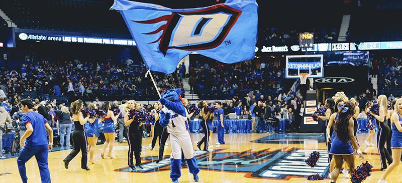 DIBS+flies+the+Blue+Demon+flag+at+the+men%E2%80%99s+basketball+game.+%28Garrett+Duncan+%2F+The+DePaulia%29