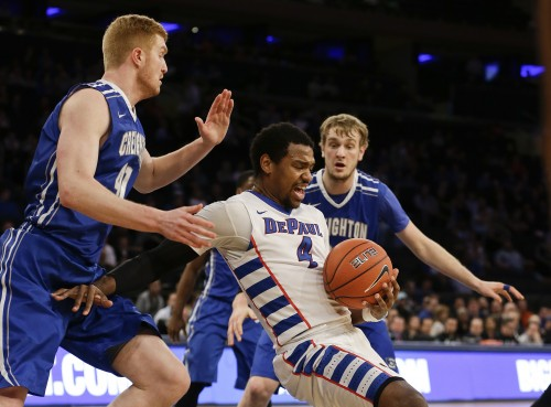 DePaul's Myke Henry (4) regains control of the ball as Creighton's Geoffrey Groselle (41) and Toby Hegner (32) defend during the first half of an NCAA college basketball game in the first round of the Big East Conference tournament, Wednesday, March 11, 2015, in New York.  (AP Photo/Frank Franklin II)