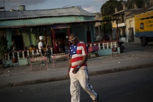 A Cuban man strolls through Santiago, Cuba, wearing clothing with American imagery. The Cuban populace has long harbored more pro-American viewpoints than mainstream media gives credit for. (AP Photo/Ramon Espinosa)
