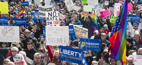Numerous efforts, ranging from pro-LGBT protests (left) to the sending of letters to Indiana politicians, preceded the amendment of  Indiana's Religious Freedom Restoration Act. (AP Photo/Doug McSchooler)