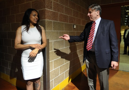 DePaul coach Doug Bruno, right, informs former player Brittany Hrynko that she had traded to the Atlanta Dream at the end of the WNBA basketball draft, Thursday, April 16, 2015, in Uncasville, Conn. (AP Photo/Jessica Hill)