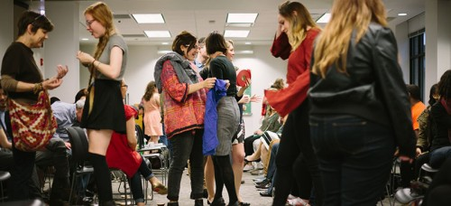 Students mingle at DePaul's second annual Fair Trade Fashion Show on Friday. Local designers and brands promoted sustainable clothing and rights for sweatshop workers.  (Garrett Duncan / The DePaulia)