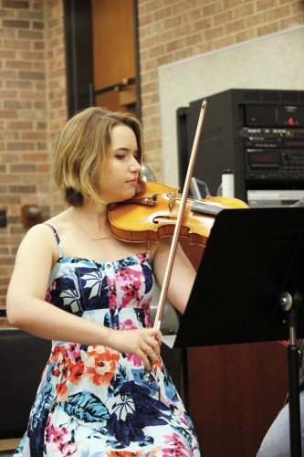 Katherine Baloff rehearses with Mux Quartet, an ensemble of fellow School of Music students. The group will likely break up after graduation. (Kirsten Onsgard / The DePaulia)