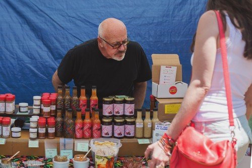 Guests peruse offerings ranging from hot sauce to bourbon to organic produce at the Green City Market in Lincoln Park. (Olivia Jepson / The DePaulia)
