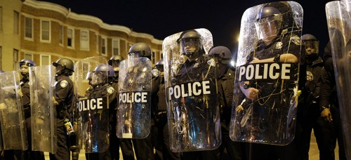 Police stood guard in Baltimore during the protests following the death of Freddie Gray in April. (AP Photo/Patrick Semansky, File)