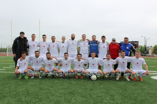 The team poses before their first match of the 2015 season, their first in the Great Lakes Premier League May 10. They won in a 4-0 drubbing in their first new league match. (Photo courtesy of RWB Adria)
