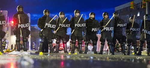 Riot police stand guard in Baltimore. Massive demonstrations ensued following the death of African-American resident Freddie Gray while in Baltimore police custody. (AP Photo/Matt Rourke)