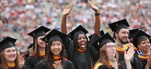 Graduates celebrate their degree at their commencement ceremony. (Amber Arnold/Wisconsin State Journal via AP)