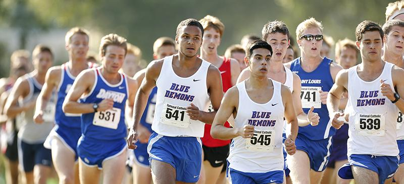 DePaul freshman Jeremy Lozano (No.  541) runs in a pack with his DePaul teammates. Lozano shaved 15 seconds off of his mile time last summer. (Photo courtesy of DePaul Athletics)