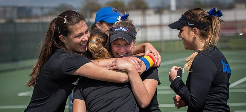 DePaul women's tennis celebrates after winning their second straight Big East championship in New York. (Photo courtesy of DePaul Athletics)
