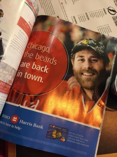 The official program of the Chicago Blackhawks has an advertisement with DePaul grad Jaeger Robertson and his beard.