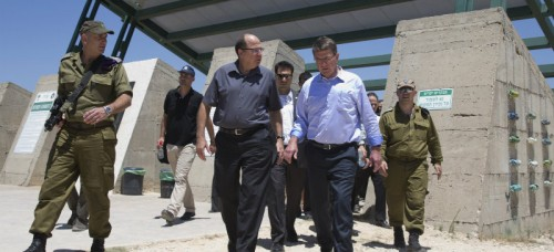 Israel Defense Forces (IDF) 91st Division Commander Moni Katz, left, Israeli Defense Minister Moshe Ya'alon, third from left, and U.S. Defense Secretary Ash Carter, second from right, walk from viewing Hula Valley from the Hussein Lookout, near Kiryat Shmona, Israel, Monday, July 20, 2015, in northern Israel along the boarder with Lebanon. Carter said he has no expectation of persuading Israeli leaders to drop their opposition to the Iran nuclear deal, but will instead emphasize that the accord imposes no limits on what Washington can do to ensure the security of Israel and U.S. Arab allies. (AP Photo/Carolyn Kaster, Pool)
