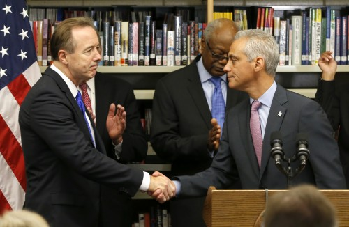 Forrest Claypool, left, shakes Chicago Mayor Rahm Emanuel's hand after Emanuel announced that Claypool will head the embattled Chicago Public Schools Thursday, July 16, 2015, in Chicago. Claypool, is currently Emanuel's chief of staff and was president of the Chicago Transit Authority during the mayor's first term. (AP Photo/Charles Rex Arbogast)
