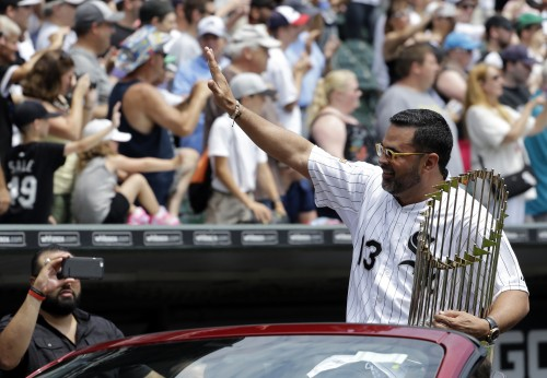 Former Chicago White Sox manager Ozzie Gullien waves to the crowd during a ceremony honoring the 10th anniversary of the 2005 World Series Champion Chicago White Sox team before a baseball game between the Kansas City Royals and the Chicago White Sox Saturday, July 18, 2015, in Chicago. (AP Photo/Nam Y. Huh)