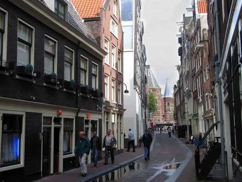 On the winding streets of Amsterdam's Red Light district, the red lights above the doors mean Amsterdam's prostitutes are open for business, legally. (Ellen Creager/Detroit Free Press/MCT)