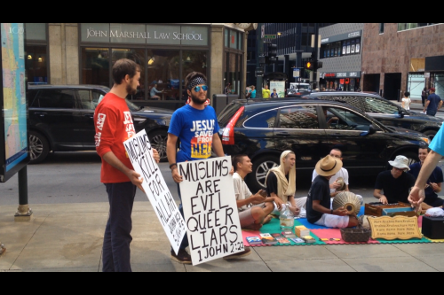 Two men who organized on an online Christian preaching website to protest what they said was a Muslim convention ended up speaking out against a group of Hare Krishnas outside the DePaul Center, Friday.