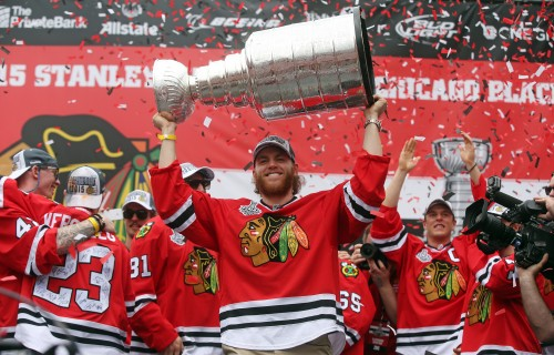 The Chicago Blackhawks' Patrick Kane raises the Stanley Cup during the championship celebration on Thursday, June 18, 2015, at Soldier Field in Chicago. (Brian Cassella/Chicago Tribune/TNS)