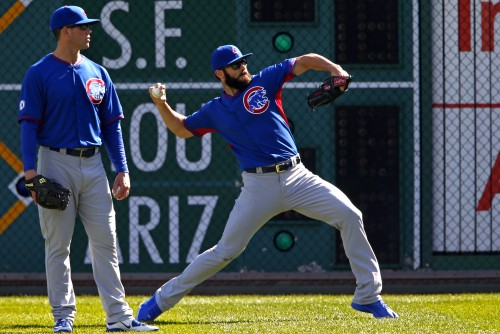 Chicago Cubs starting pitcher Jake Arrieta, right, throws in the outfield with Clayton Richard watching during workout day, Tuesday, Oct. 6, 2015, for Wednesday's National League Wild Card baseball game against the Pittsburgh Pirates at PNC Park in Pittsburgh.(AP Photo/Gene J. Puskar)