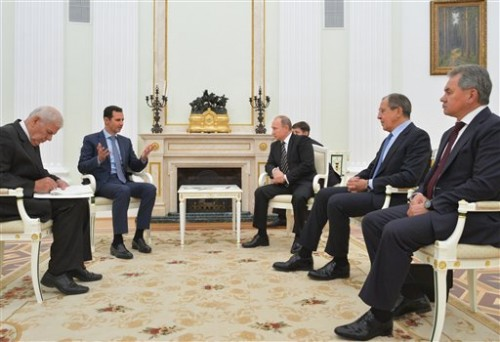 In this photo taken on Tuesday President Bashar Assad was in Moscow, in his first known trip abroad since the war broke out in Syria in 2011, to meet his strongest ally Russian leader Vladimir Putin. The two leaders stressed that the military operations in Syria — in which Moscow is the latest and most powerful addition — must lead to a political process.(Photo courtesy of Alexei Druzhinin, RIA-Novosti, Kremlin Pool | Associated Press.)