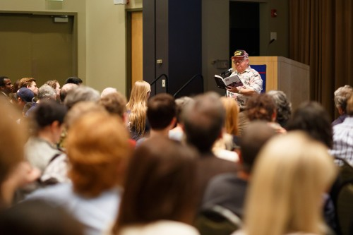 "A veteran reads from ""I Remember: Chicago Veterans of War"" in the Lincoln Park Student Center. The event was organized by graduate students. (Connor O'Keefe / The DePaulia)"