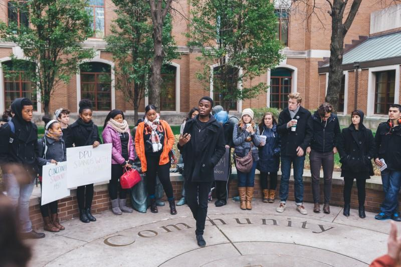 Elijah Obasanya, president of MOVE, asks students to reflect on racial inequality not only at Mizzou, but also at DePaul Thursday. (Josh Leff / The DePaulia)